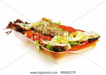health dinner - atlantic light roast fish sea tuna served on plate with vegetables and lemon isolated on white background