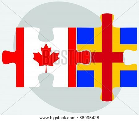 Canada And Aaland Islands Flags In Puzzle