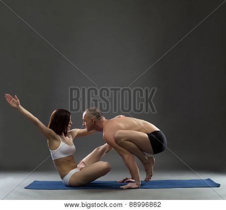 Yoga. Image of trainers posing in difficult asana
