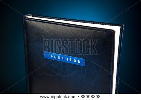 business book against blue background
