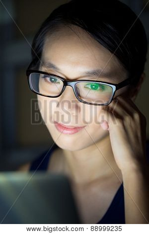 Young woman with laptop at night