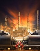 stock photo of land-mass  - industrial trains and railways against heavy petrochemical industry use for rails logistic and mass land transportation business - JPG