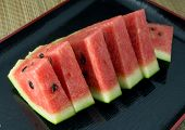 pic of watermelon slices  - Fresh Fruits Sliced Ripe and Sweet of Refreshing Watermelon on A Black Tray - JPG