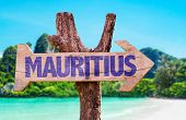 stock photo of mauritius  - Mauritius wooden sign with beach background - JPG