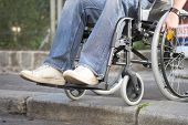 stock photo of rollator  - man on a wheelchair who came to a bareer - JPG