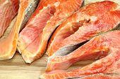 foto of lax  - Fresh Raw Salmon Fish Steaks On Wood Cutting Board Close - JPG