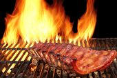 picture of baby back ribs  - BBQ Pork Spicy Spare Ribs Marinated And Smoked Pork Ribs On The Hot Charcoal Grill With Bright Flames On Black Background - JPG