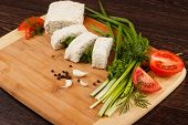 pic of pita  - pita bread with green onion and tomato on a wooden table - JPG