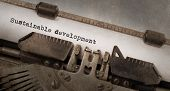 stock photo of sustainable development  - Vintage typewriter old rusty and used Sustainable development - JPG