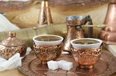 stock photo of sugar cube  - Copper dishware with Turkish coffee and sugar cubes - JPG