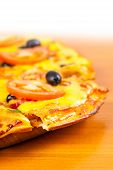 image of hot fresh pizza  - hot fresh pizza closeup on wooden background - JPG