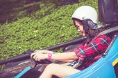 picture of driving  - Cute Thai girl is driving Go - JPG