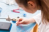 pic of assembly line  - Young woman assemble optic sensor for intelligent robot system - JPG