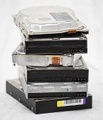 picture of outdated  - Old hard disk drives in a pile  - JPG