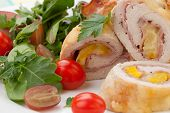 picture of kale  - Tasty chicken prosciutto roulade stuffed with cheese and pineapple served with baby kale grapes and cherry tomatoes salad - JPG