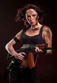 foto of ak 47  - Sexy blond woman killer holding automatic gun ak 47 - JPG