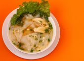 foto of glass noodles  - Glass noodle soup with chicken and beansprouts on an orange background - JPG