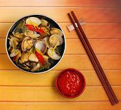 image of clam  - herbal clam soup Vietnam style served on a wood table top - JPG