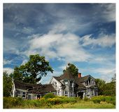 stock photo of abandoned house  - Abandoned house in a blue sky - JPG