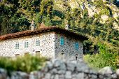 stock photo of albania  - Ancient house with blue windows in Berat city, Albania