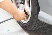 foto of air pressure gauge  - Inflate tires and check Pressure of tires - JPG