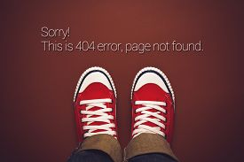 stock photo of not found  - Top View of 404 Error Page Not Found Person in Red Sneakers Standing on Brown Background with Internet Error Message - JPG