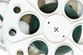 picture of mm  - Original old big movie reel for 35 mm film projector film loaded detail on neutral background - JPG