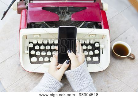 Girl With Cell Phone And Typewriter