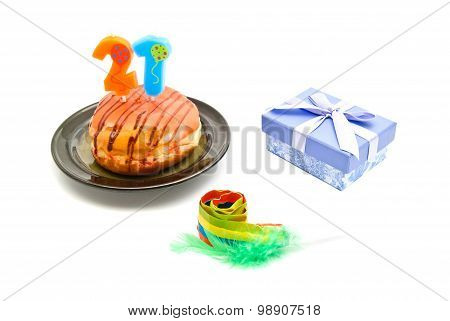 Donut With Twenty One Years Birthday Candle, Whistle And Gift On White