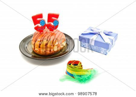 Donut With Fifty Five Years Birthday Candle, Whistle And Gift On White
