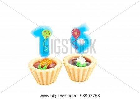 Cakes With Sixteen Years Birthday Candles On White
