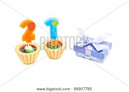 Cakes With Twenty One Years Birthday Candles And Gift On White