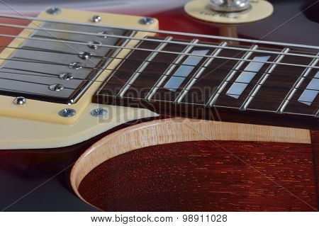 Detailed View On The Brown Electric Guitar
