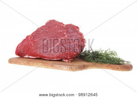 fresh raw red beef meat big steak chunk on wooden cut board isolated over white background