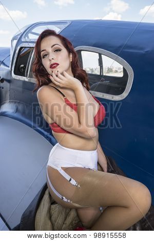 Summer, pinup dressed in era of the Second World War, beauty redheaded woman