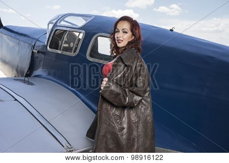 pilot, pinup dressed in era of the Second World War, beauty redheaded woman