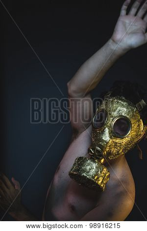 environmental, depression and danger man with golden gas mask