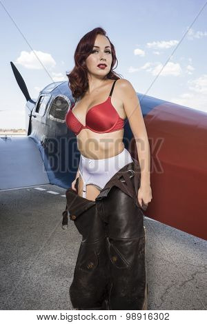 Style, pinup dressed in era of the Second World War, beauty redheaded woman