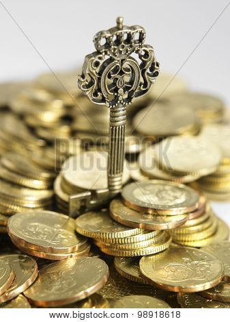 key on piles of gold coins