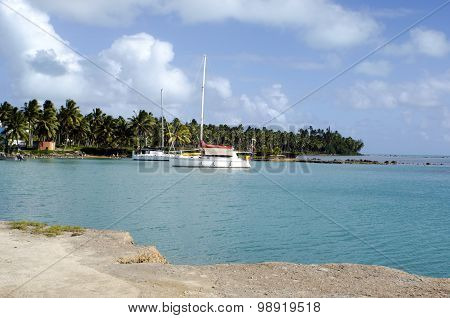 Luxury Cruises yachts moors at Port of Aitutaki on Sep 17 2013.Cooks Islands reef passages are too narrow or too shallow to allow large ships to transfer passengers and freight to shore.