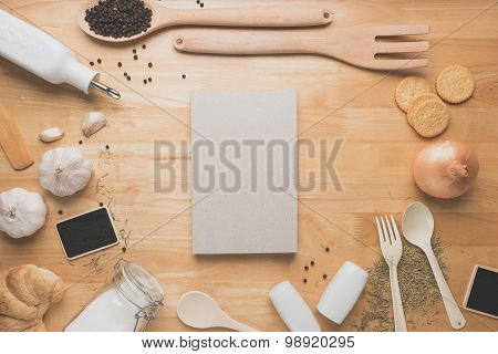 Top view kitchen mockup,Rural kitchen utensils and ingredients and note book on wooden table