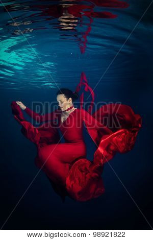 Red dress underwater