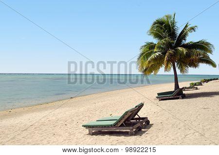 Empty Beach Chairs On Empty Tropical Beach