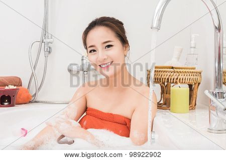 Beautiful Asian beauty woman in bath with rose petal. body care andTreatments For Skin Rejuvenation
