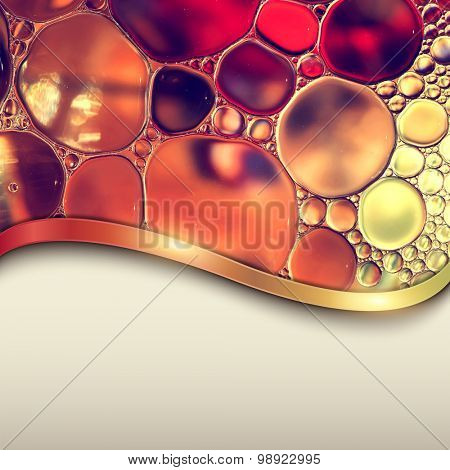 Abstract background with oil drops on water, macro with copyspace.