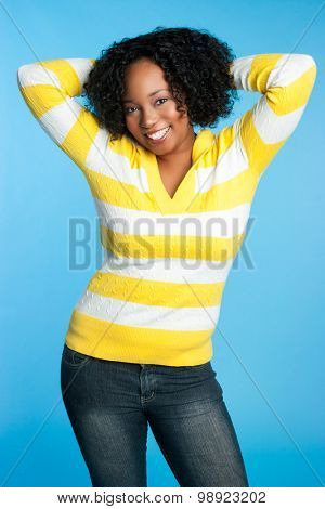 Pretty smiling black woman on blue background