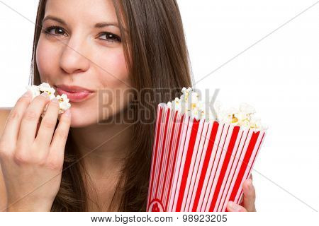Beautiful girl eating popcorn on white background
