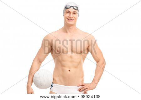 Young male water polo player holding a ball and looking at the camera isolated on white background
