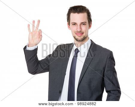 Young businessman with ok sign gesture