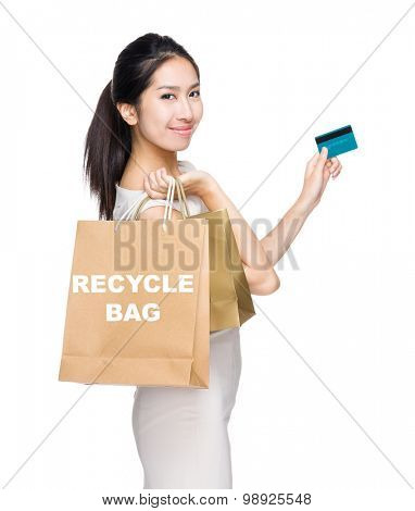 Happy shopping woman credit card and shopping bag for showing recycle bag